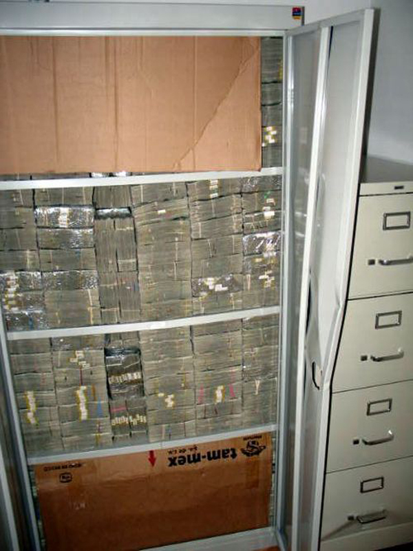 15-Stacks-of-cash-were-found-in-every-nook-and-cranny