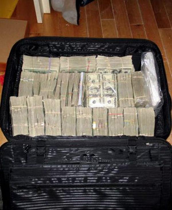 17-18-plastic-bins-filled-with-100-dollar-bills-were-found