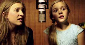 Søstrene er bare 11 og 15 år. Jeg sitter med vidåpen munn når jeg hører dem synge. WOW.