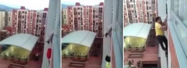 Heroisk mann risikerer livet for å redde hund som henger fra balkong i en høyblokk.
